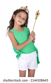 Little fairy girl wears a green t-shirt and crown with a magic wand, isolated on white background