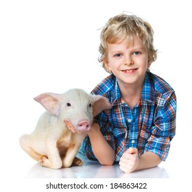 Little farmer. Cute boy with pig. Isolated on white background.