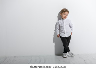 Little fashionable boy. Isolated on white background