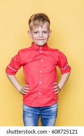 Little fashionable child with pink shirt. Fashion model. Spring. Summer. Studio portrait over yellow background