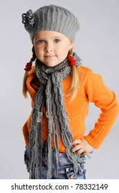 Little fashionable girl in warm clothes