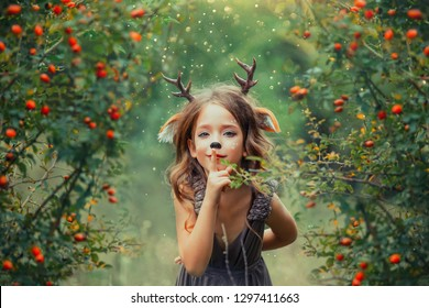 little fawn in a barberry dog rose grove, faun child plays hide-and-seek and holds a finger to lips, keeps a secret, a light brown dress with purple tint, fabulous makeup, homemade antlers, deer ears
