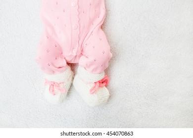 little feet girls soft blanket. Warm boots made of wool. Pink bodykit.