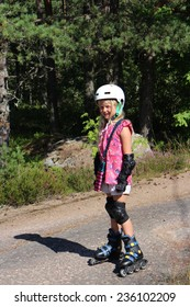 Little Finnish girl rollerblades