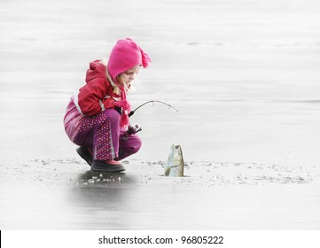 Little fisherman catching a fish on ice.
