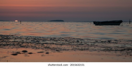 A little fishingboat in the sunset