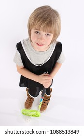 Little floorball player boy holding a floorball stick
