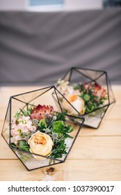 Little florariums with fresh bouquet stands on the table. Decor. Reception