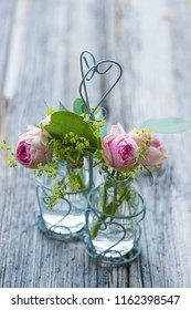 Little flower bouquet with roses