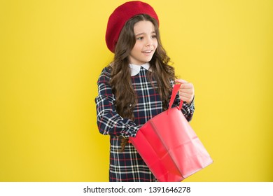 Little french lady adore shopping. Birthday girl. Favorite brands hottest trends. Girl with shopping bag. Explore fashion industry. Shopping and purchase. Black friday. Sale discount. Shopping day.