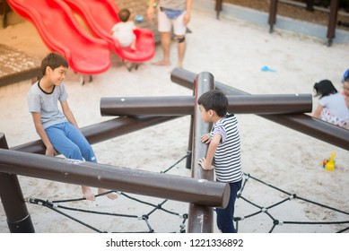 Little friendship sibling boy play together at playground outdoor