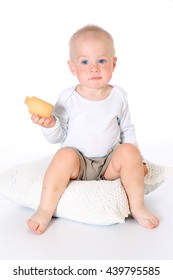 little funny baby boy holds and eats cookies