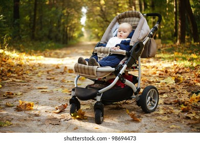 little funny baby in carriage