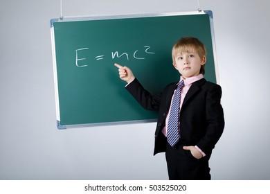 little funny boy with blackboard