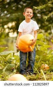 little funny boy with pumpkin