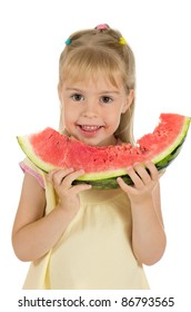Little funny girl eating a watermelon. Healthy Eating.