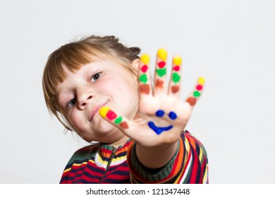 Little funny girl with painted hands