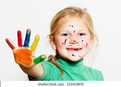 Little funny girl with painted hands and face