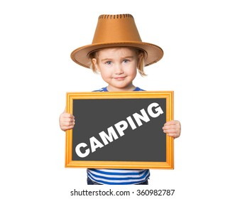 Little Funny girl in striped shirt with blackboard. Text CAMPING. Isolated on white background.
