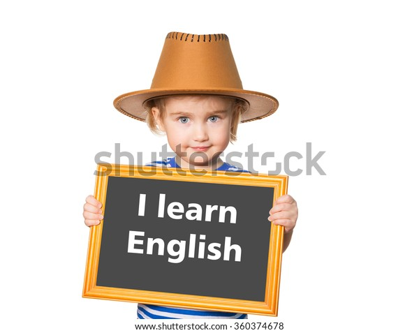 Little Funny girl in striped shirt with blackboard. Text  I learn english.  Isolated on white background