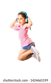 Little funny jumping and shouting little caucasian girl with a headphones on white background