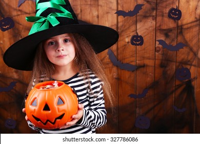 Little funny witch on dark background with vector images
