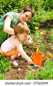 Little gardener helping mom