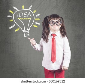 Little genius girl having an idea. Education, innovation and creativity concept