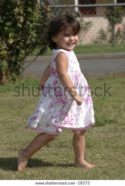 little gilr so happy while runningh