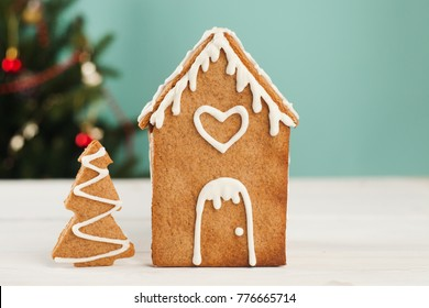 Little gingerbread house with glaze standing on table