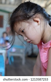Little girl is absent-minded