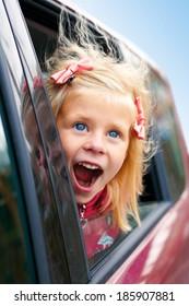 little girl admiring looks of the car on the street