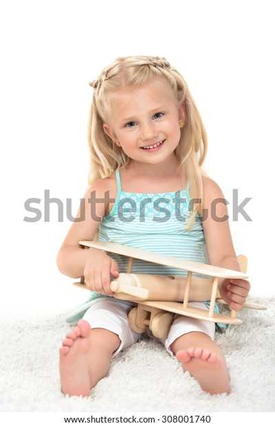 little girl with aircraft in hands