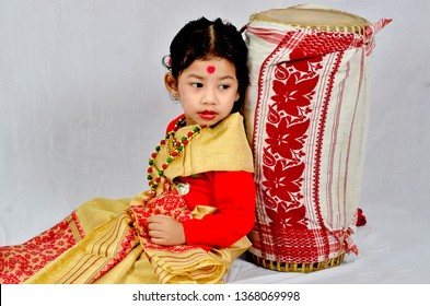 A little girl in Assamese traditional costume