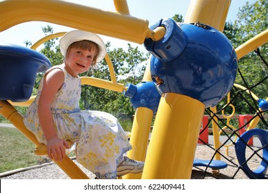 Little girl with autism playing on an adaptive playground for special needs children