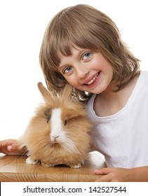little girl with a baby rabbit - portrait