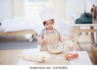Little girl baking in a kitchen