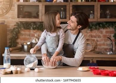 Little Girl Baking In Kitchen With Her Dad, Preparing Dough For Cookies Together, Having Fun At Home, Free Space