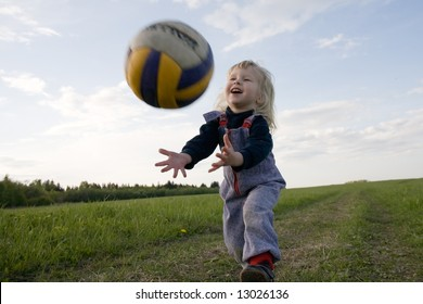 little girl with ball in hands