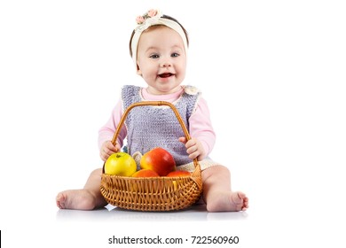 Little girl with a basket of apples on a white background.