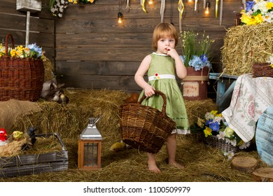 Little girl with a basket in her hand in a rustic interior