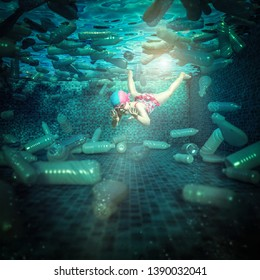little girl in a bathing suit swims in a pool full of plastic bottles. Concept of environmental problem and differentiated waste collection.