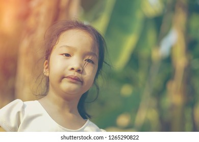 Little girl be absent-minded with nature background