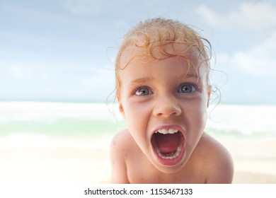 little girl at the beach shouting out loud