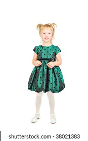 Little girl in beautiful green dress isolated on the white background.