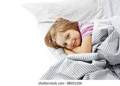 little girl in the bed isolated
