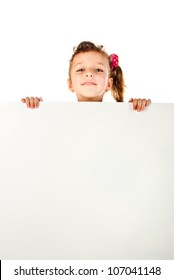 little girl behind a white board