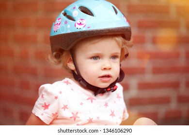 little girl with bicycle helmet smiling