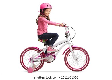 Little girl with a bicycle isolated on white background
