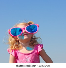 little girl in big glasses